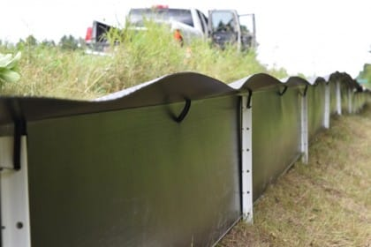 A view of the safe-side of the  fencing, highlighting the smooth surface and angled lip to prevent fence breaches