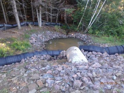 ACO fence abutting drainage tunnel